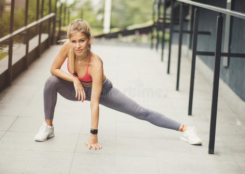 Stretching is important part of sport. Young sport women. royalty free stock images