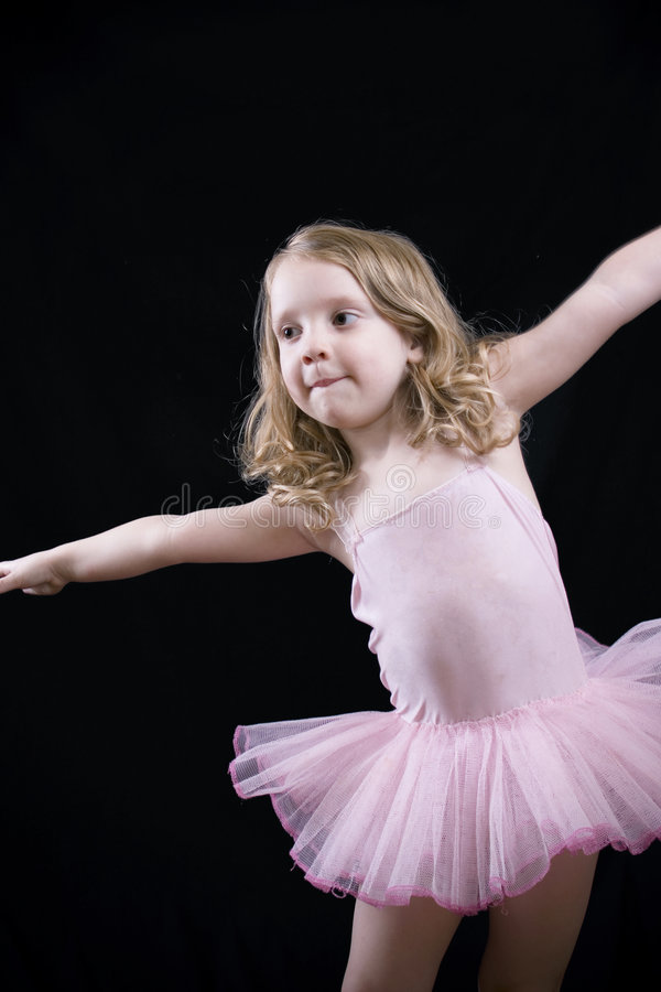 Stretching little girl royalty free stock photos