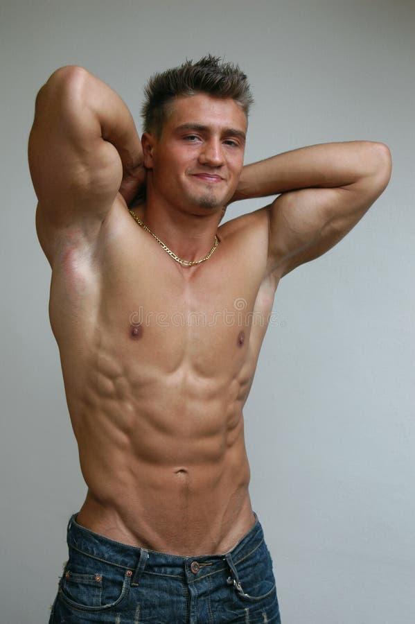 Stretching Muscular Man. Stretching muscular male model royalty free stock photo