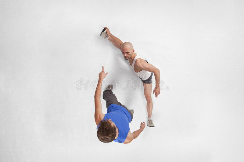 Stretching with personal trainer royalty free stock photography