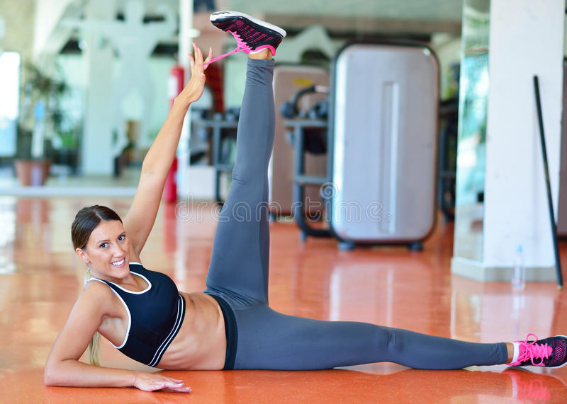 Stretching pilates exercises in fitness studio stock photography