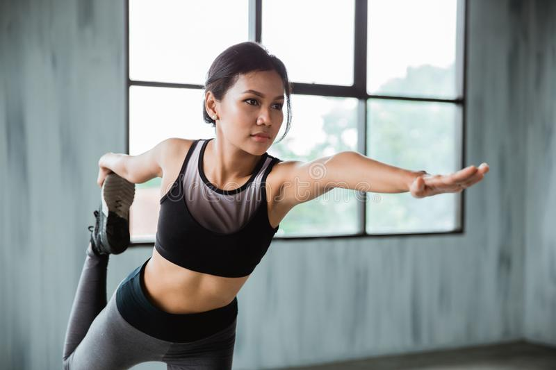 Stretching sport woman in sport wear indoor stock photo