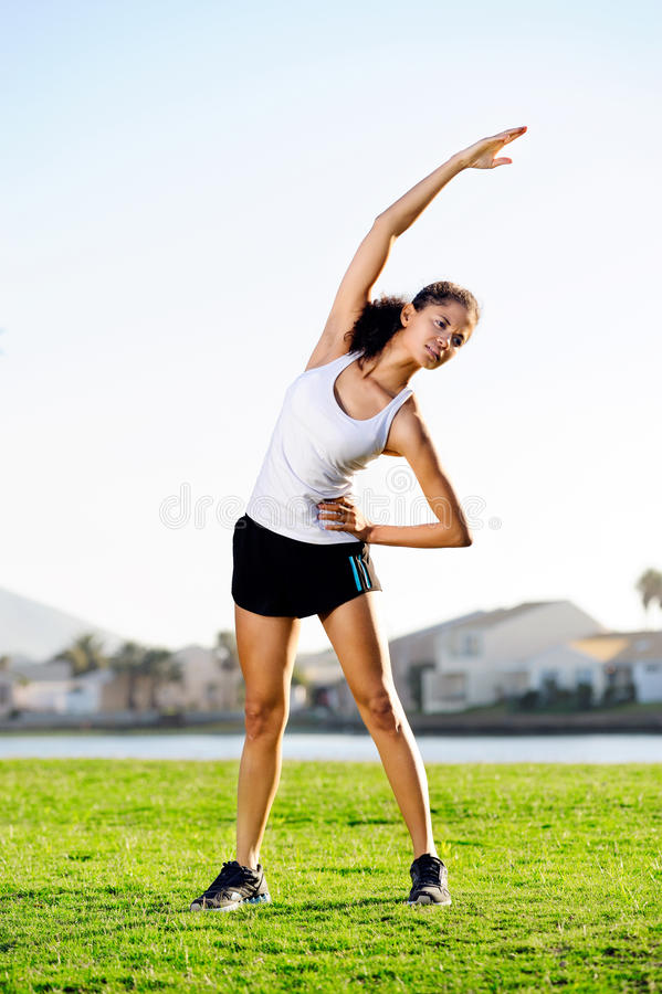 Stretching sporty woman royalty free stock photography