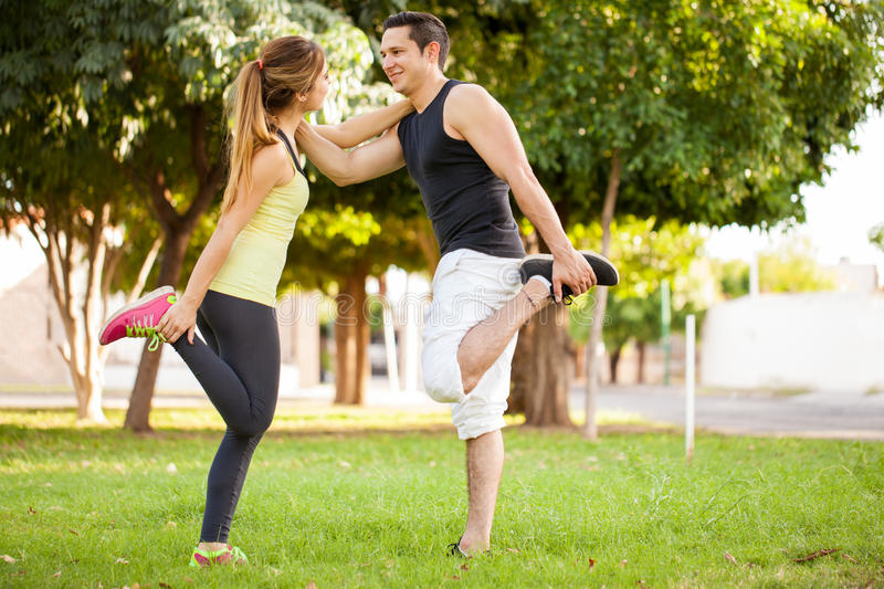 Stretching and warming up together royalty free stock images