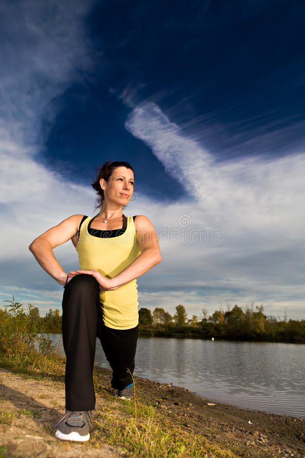 Download Stretching woman stock photo. Image of adult, action - 27215822