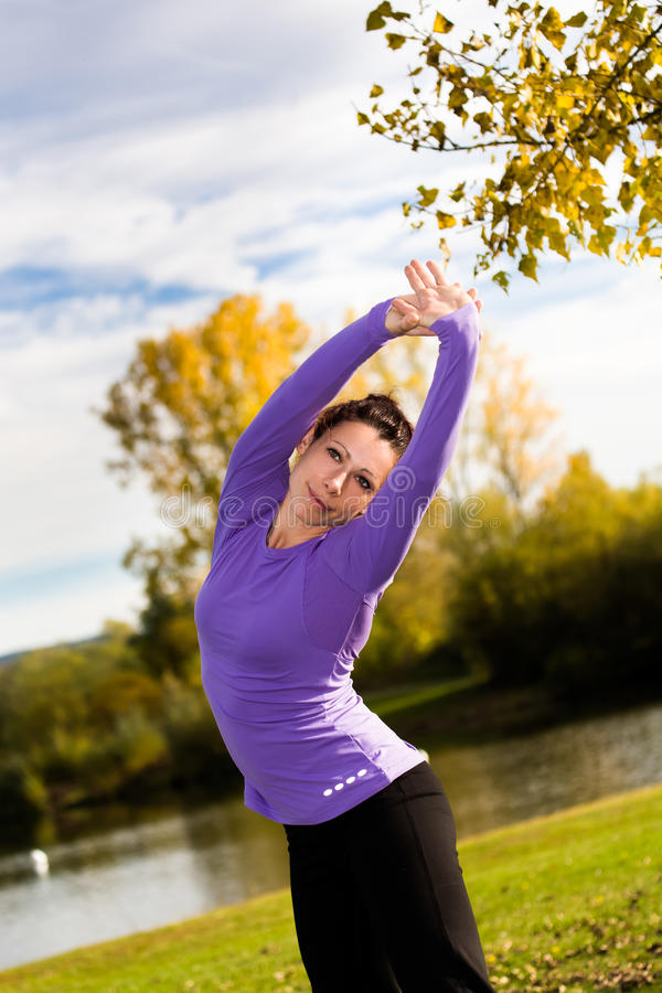 Download Stretching woman stock photo. Image of people, action - 27250778