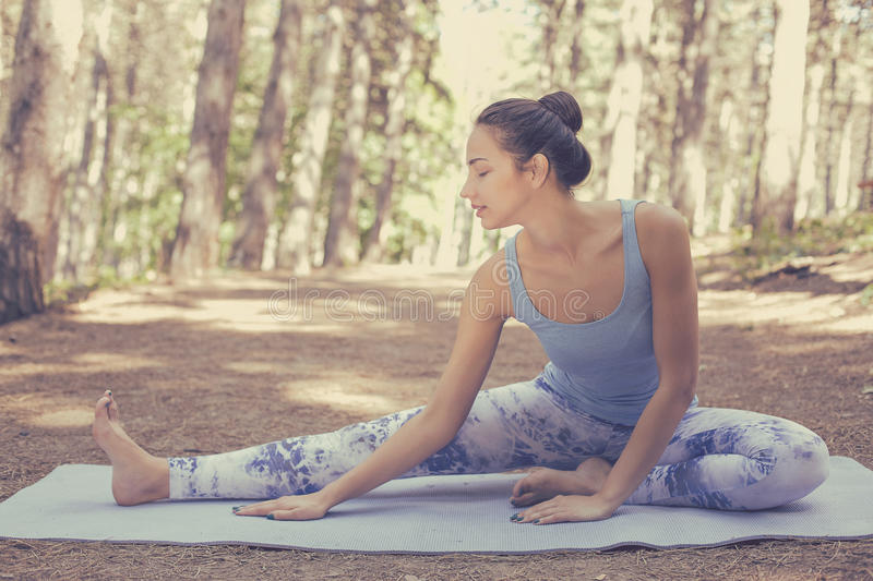 Stretching woman in outdoor exercise smiling happy doing yoga stock images