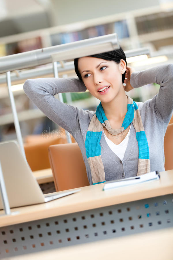 Stretching woman working on the laptop royalty free stock image