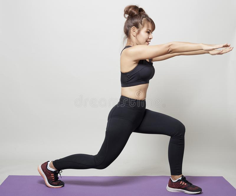 Stretching workout posture by a asian woman stock image