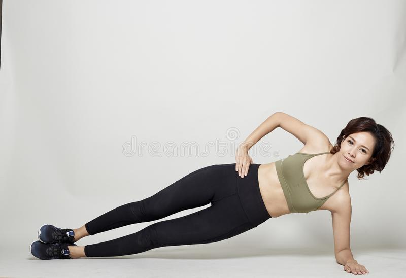 Stretching workout posture by a asian woman royalty free stock images