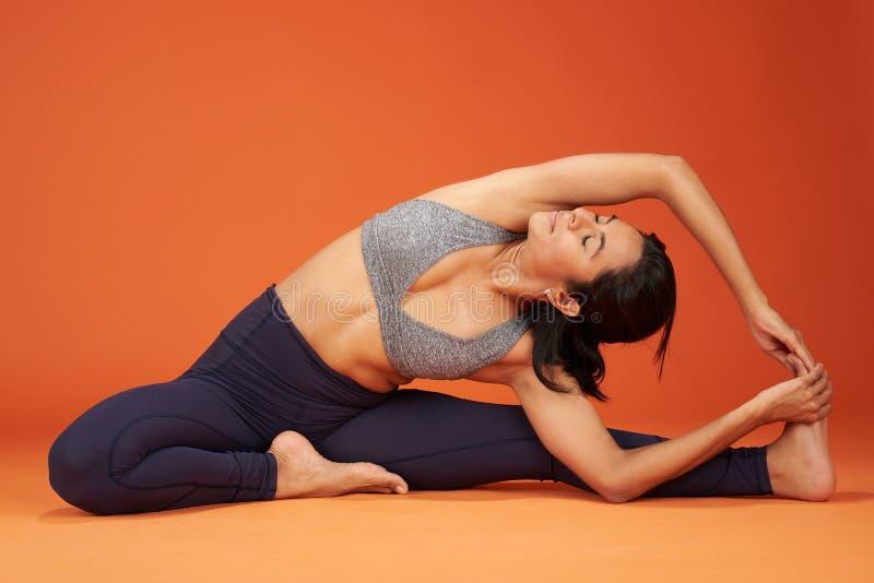 Stretching yoga asana pose stock photography
