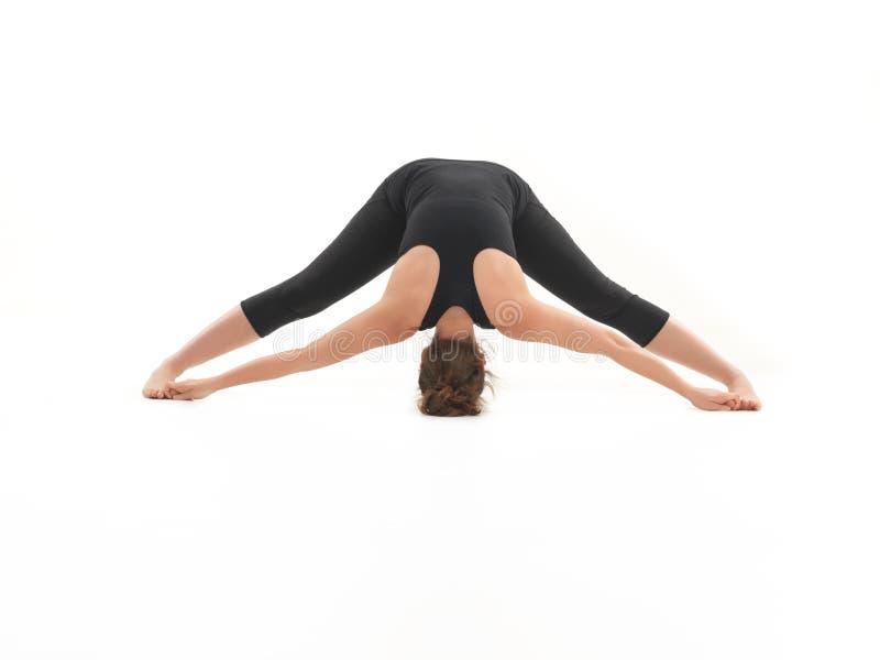 Stretching yoga pose demonstration stock photos