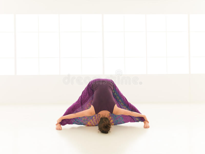 Stretching yoga pose demonstration stock image