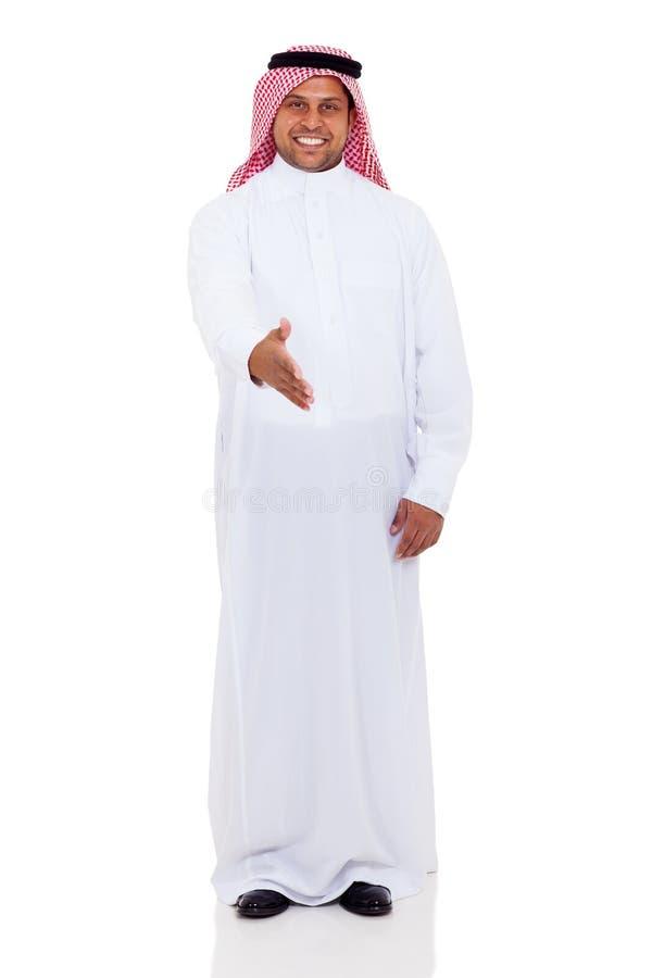 Stretta di mano araba dell'uomo fotografie stock
