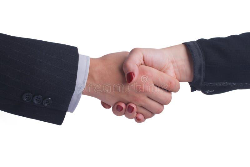 Stretta di mano fra la mano femminile e maschio in uno stile di affari fotografie stock
