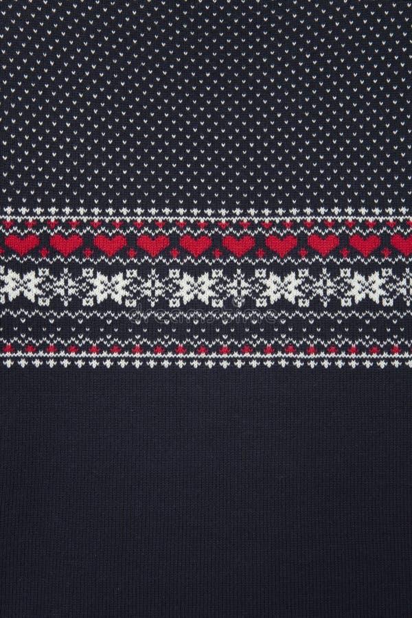 Strickende Muster der Weihnachtsstrickjacke Gestrickte Beschaffenheit stockbilder