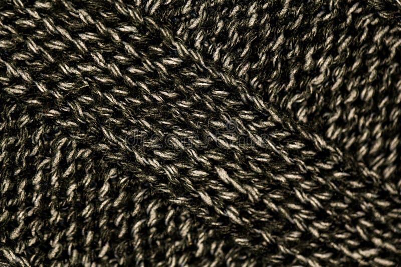 Strickendes Muster vom grauen woolen warmen weichen Garn lizenzfreies stockfoto
