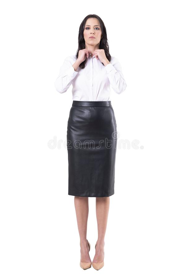 Strict authoritative business woman or teacher getting ready dressing up. Full body isolated on white background stock images