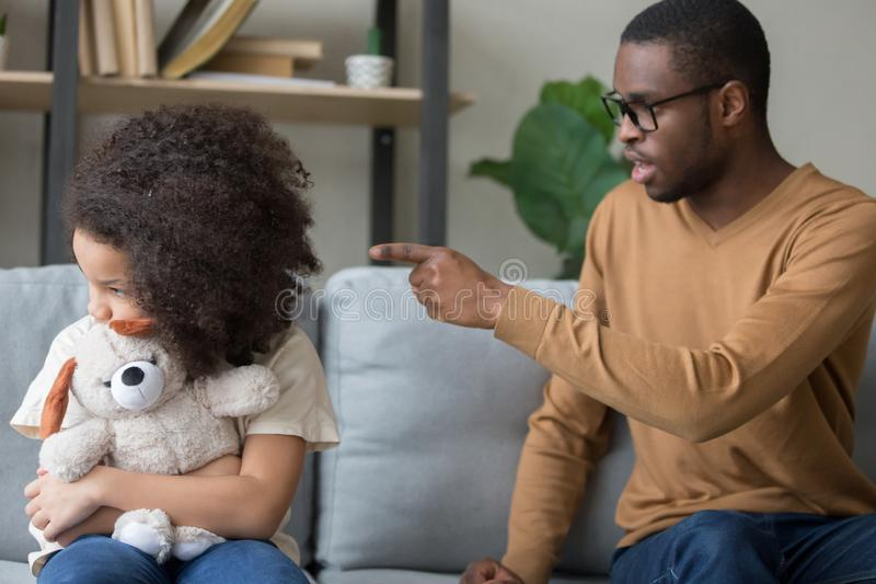 Strict black dad discipline offended preschooler daughter royalty free stock images