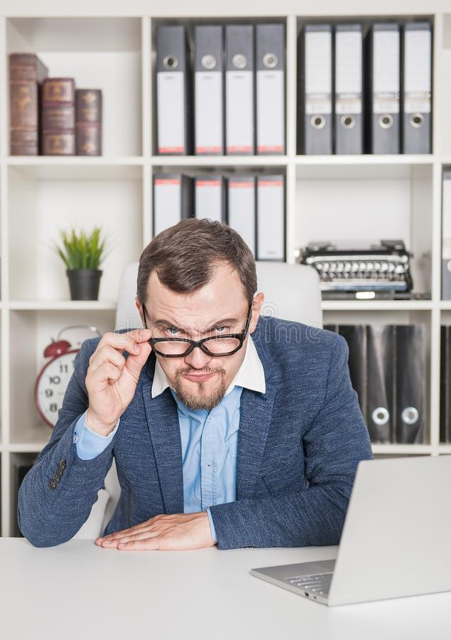 Strict business man boss looking serious. In office royalty free stock images