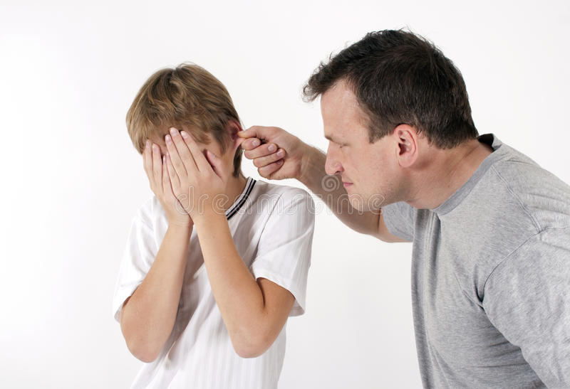 Strict father punishes his son. royalty free stock photography