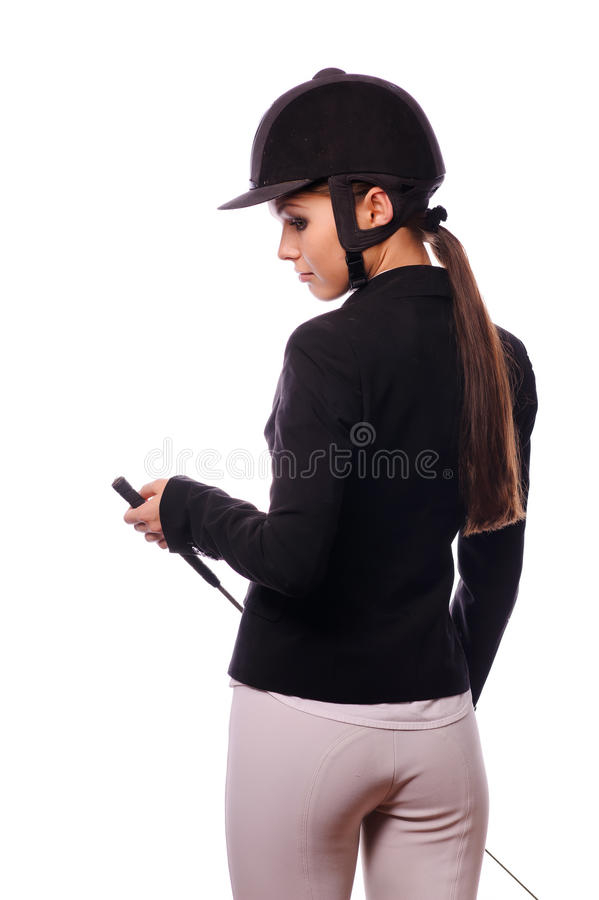 Strict Jockey With Thin Switch Royalty Free Stock Image