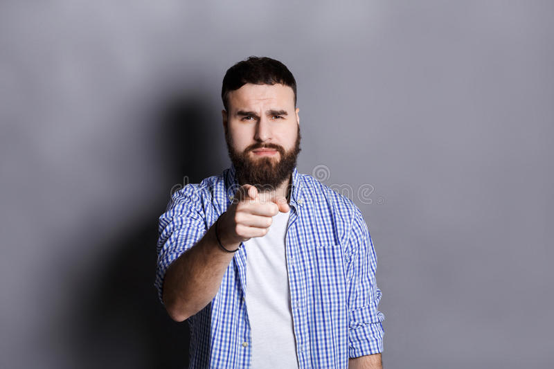 Strict man point gesturing index finger on you royalty free stock photography