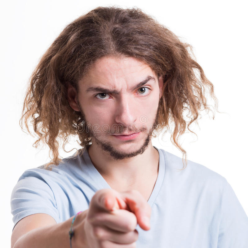 Strict man point gesturing index finger on you stock images