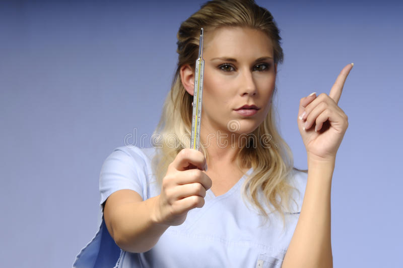 Download Strict medical nurse stock photo. Image of blue, celsius - 19087556