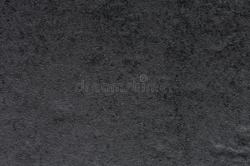 Strict synthetic stone background in dark grey tone. stock photo