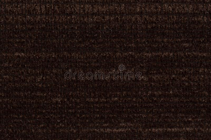 Strict textile background in awesome dark brown colour. stock photo