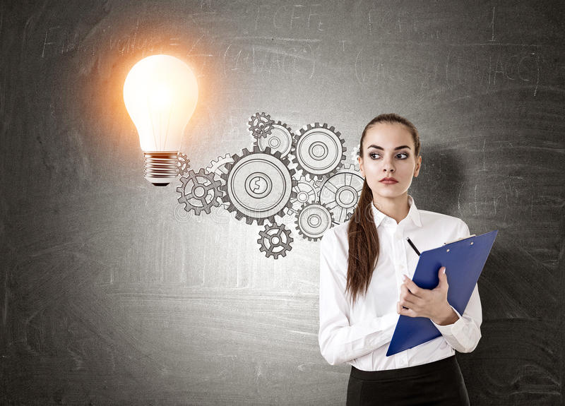 Download Strict Woman Near Light Bulb Stock Photo - Image: 83722277