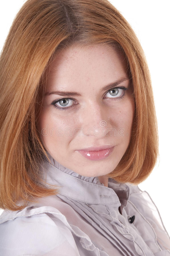 Strict young woman in blouse. Portrait of strict beautiful looking at a camera young woman in blouse royalty free stock photo