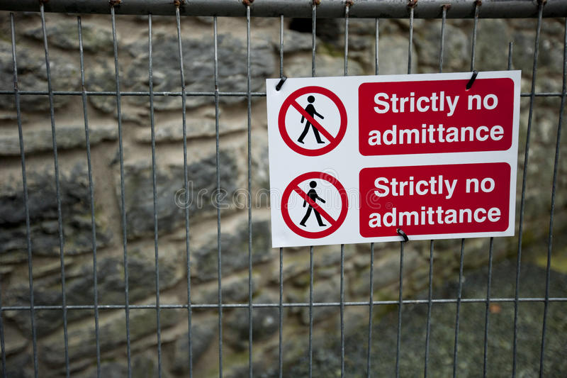 Strictly No Admittance sign on fence royalty free stock photo