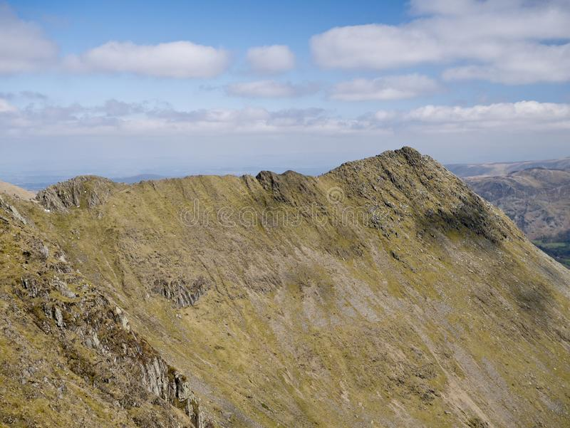 Striding Edge in the North West Lake District in Cumbria, England, UK. On a sunny day in spring: A popular route linking the summit ridge of Birkhouse Moor to royalty free stock photos