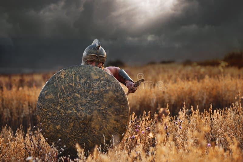 Strijder als het Spartaanse doorgaan in aanval stock foto's