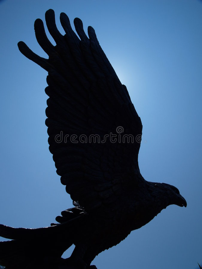Striking Eagle Statue. A statue of a huge eagle statue royalty free stock photo