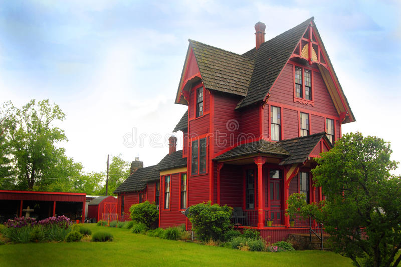 Striking Historical Farm Home. Side view of a nice large old historical home under a clear blue sky royalty free stock photos