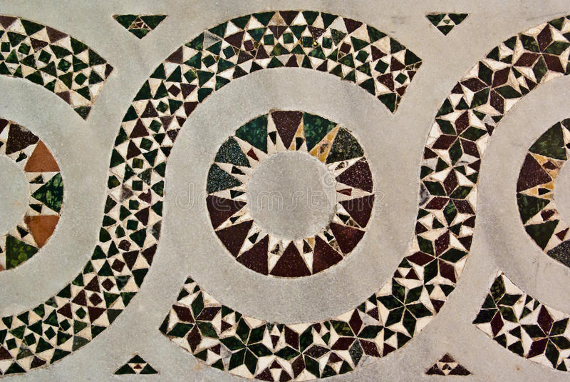 Striking Inlaid Geometric Design. Striking stylised repetitive inlaid geometric design, ornamental architectural background stock photos