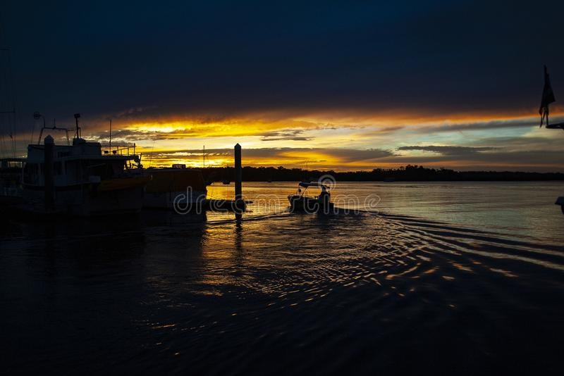 Vibrant Golden colored dramatic cloudy Marina Sunset royalty free stock image