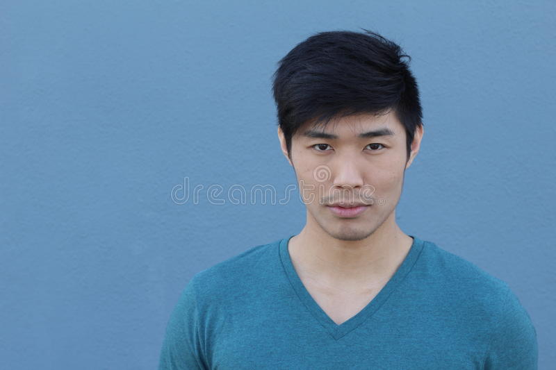 Striking man with neutral expression close up with copy space.  stock photos