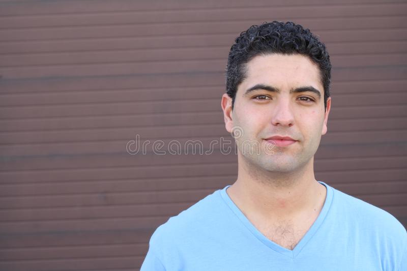 Striking man with neutral expression close up with copy space.  stock image