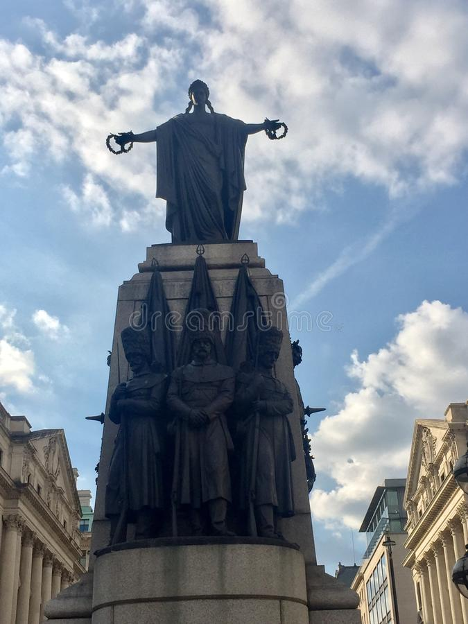 Statue. A striking statue in Central London daytime royalty free stock photo