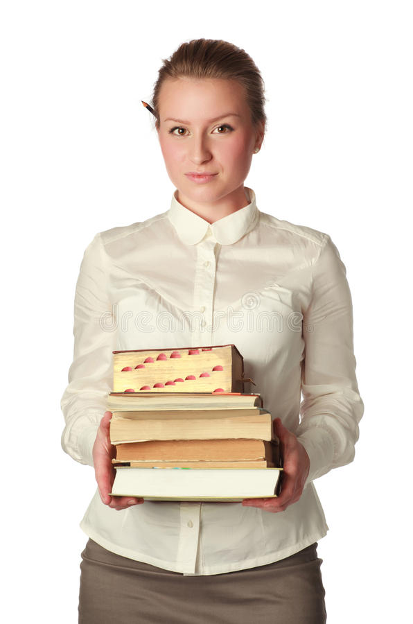 Strikte leraar met boeken en pen royalty-vrije stock afbeeldingen