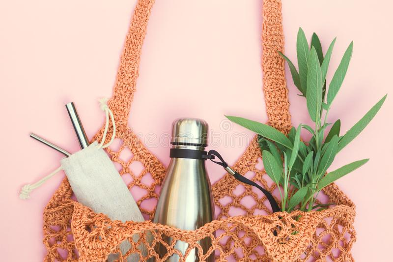 String bag with reusable water bottle and metal straws, go green and use no single use plastic. Eco-friendly lifestyle, string bag with reusable water bottle and royalty free stock photos