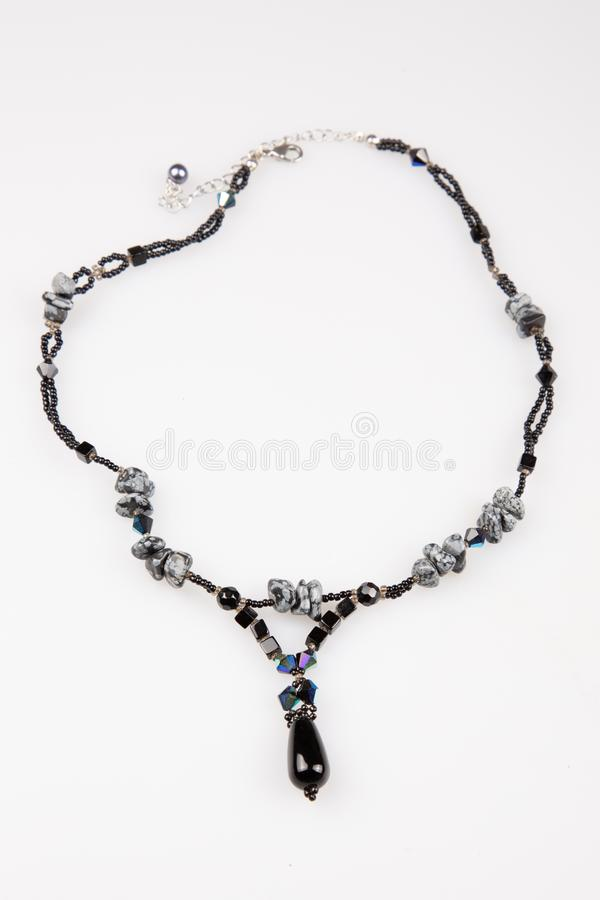 String beads black necklace on white background stock photos