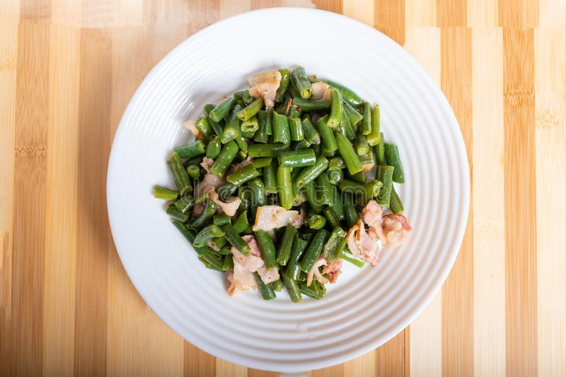 String Bean Salad with Bacon. On the plate stock photos