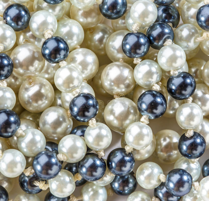 String of black and white pearls royalty free stock images