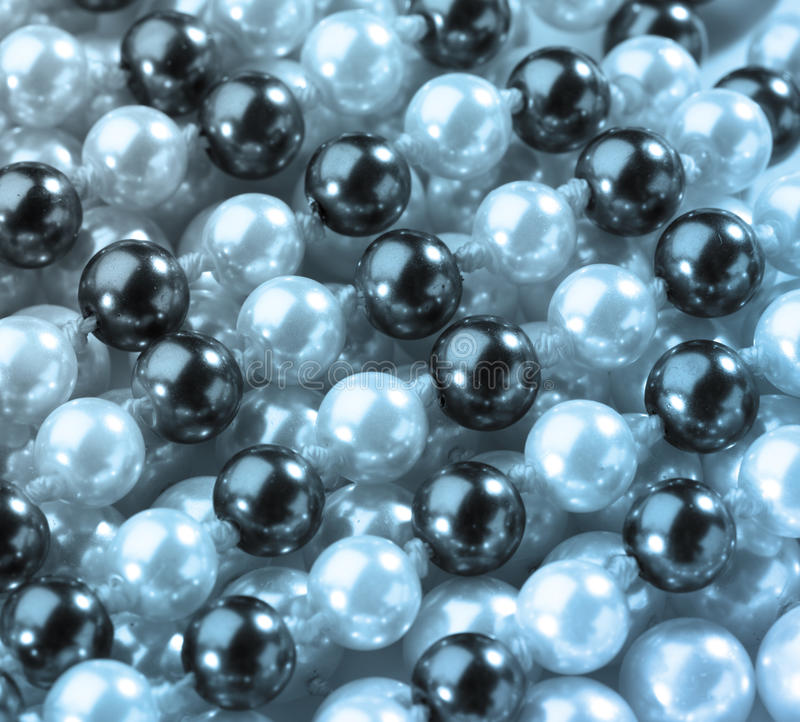 String of black and white pearls stock photos