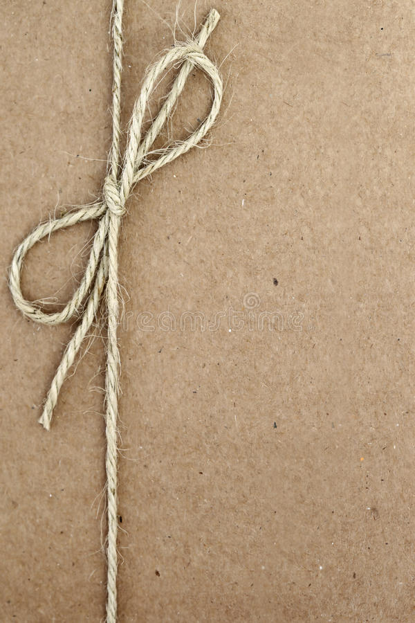 Free String Bow On Brown Paper Stock Photo - 22999590